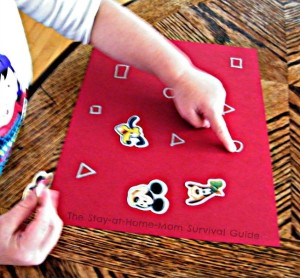 Learning letters and shapes with stickers toddler activity.