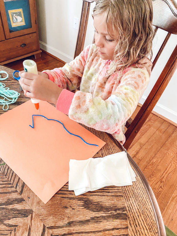 Yarn pictures art activity great for summer indoor fun or art on a rainy day.