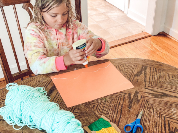 Children can do these art activities with yarn indoors or outside on a nice day.