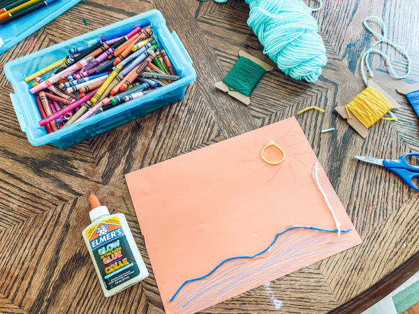 Supplies you need to do this yarn pictures art activity for kids at home.