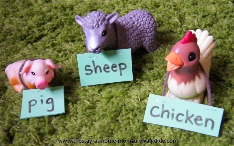 Toddler activity for learning animal names with simple animal nametags.