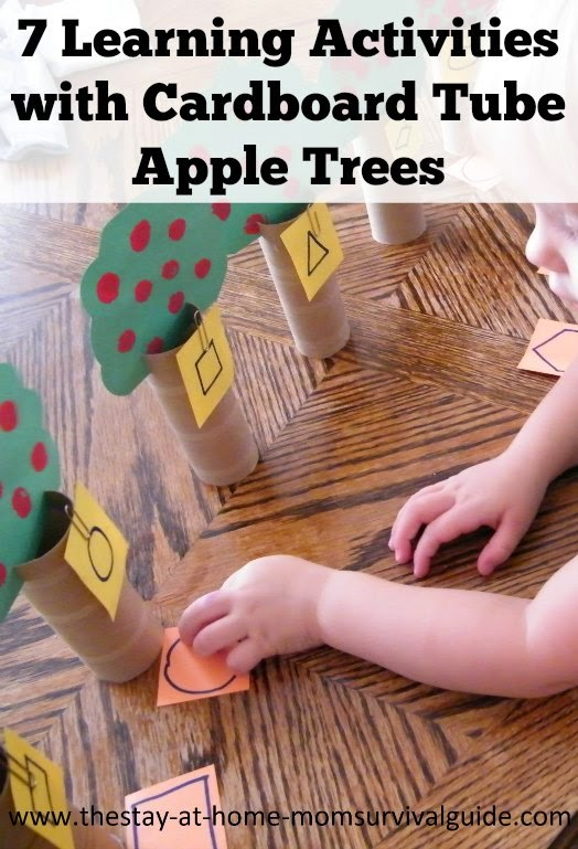 Toddler learning activities with homemade apples trees made from toilet paper tubes.