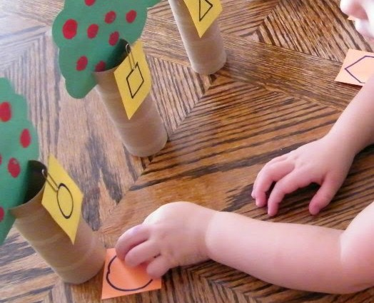 7 learning activities with cardboard tube apple trees that cover all ages from toddlers to school age kids.