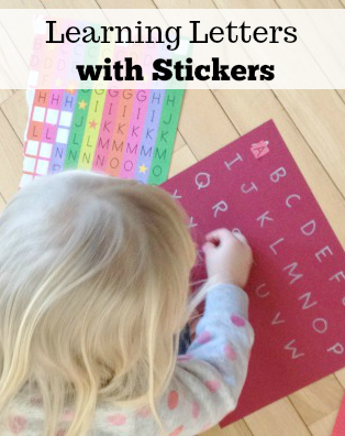 Learning letters and shapes with stickers preschool activity at home.