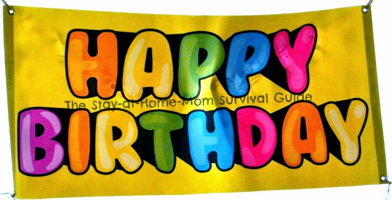 Basic Happy Birthday Banner from BuildASign.com as a reusable kids birthday decoration reviewed at The Stay-at-Home-Mom Survival Guide