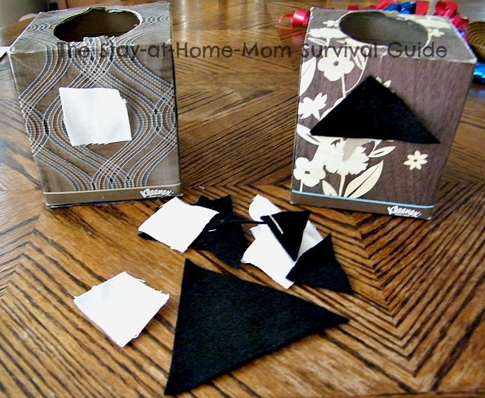 Cut fabric scraps are taped to the kleenex boxes to sort by color and shape