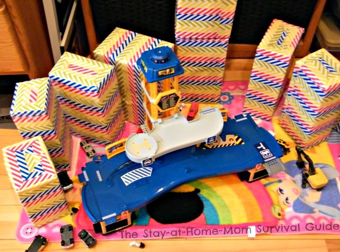 Children get creative using jumbo building blocks in their creative pretend play. DIY blocks idea from The Stay-at-Home-Mom Survival Guide.