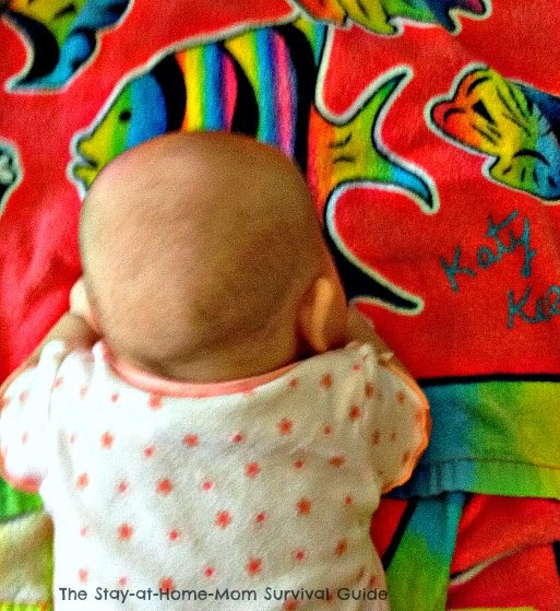 Using a colorful beach towel for tummy time. Idea from The Stay-at-Home-Mom Survival Guide.