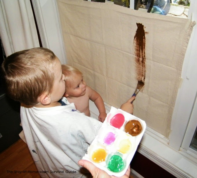 Painting on a drop cloth canvas plus 19 other ideas for toddlers at home.