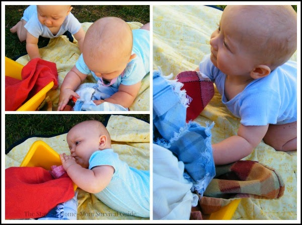 Babies play with a simple infants sensory activity using cloth napkins or fabric scraps PLUS a little surprise for the senses!