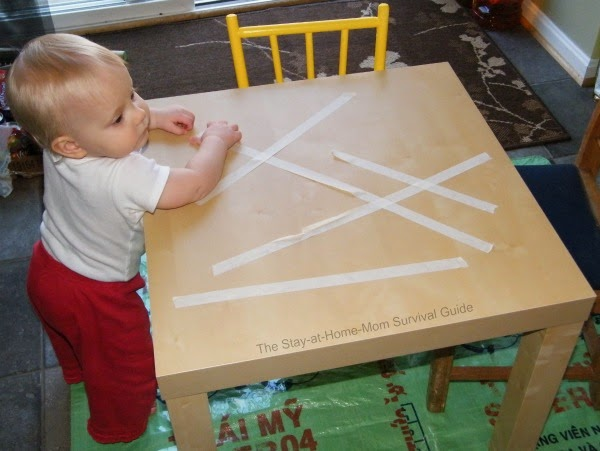 Toddler tape removal activity only requires one supply and works in fine motor skills.