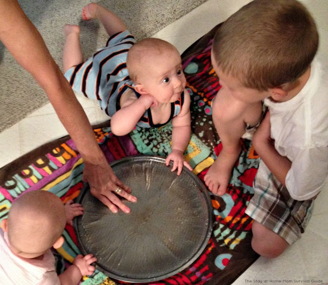 Tips for infant water play indoors. Great sensory activity that can be done without too much mess indoors.