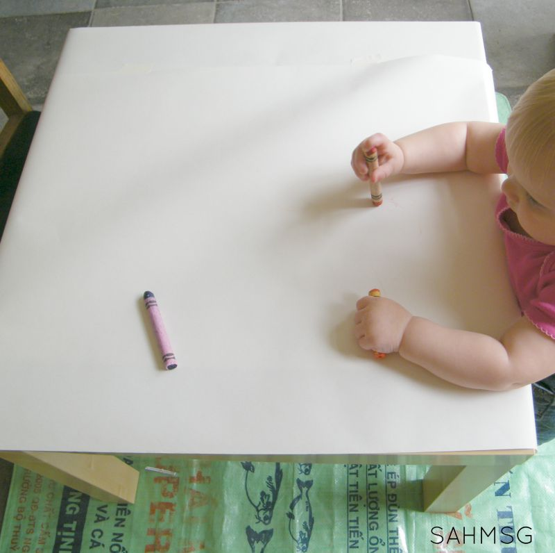 Writing activities for toddlers: simple invitation to color with crayons.