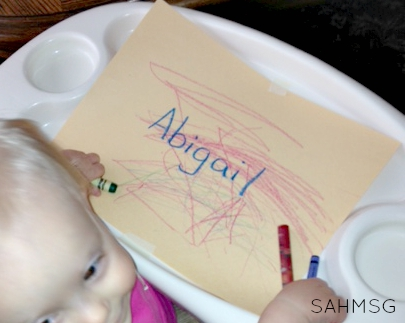 Simple writing activity for toddlers that teaches how to spell their name.