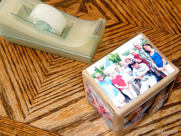 DIY photo blocks with family photos to add interest to play for infants and toddlers.