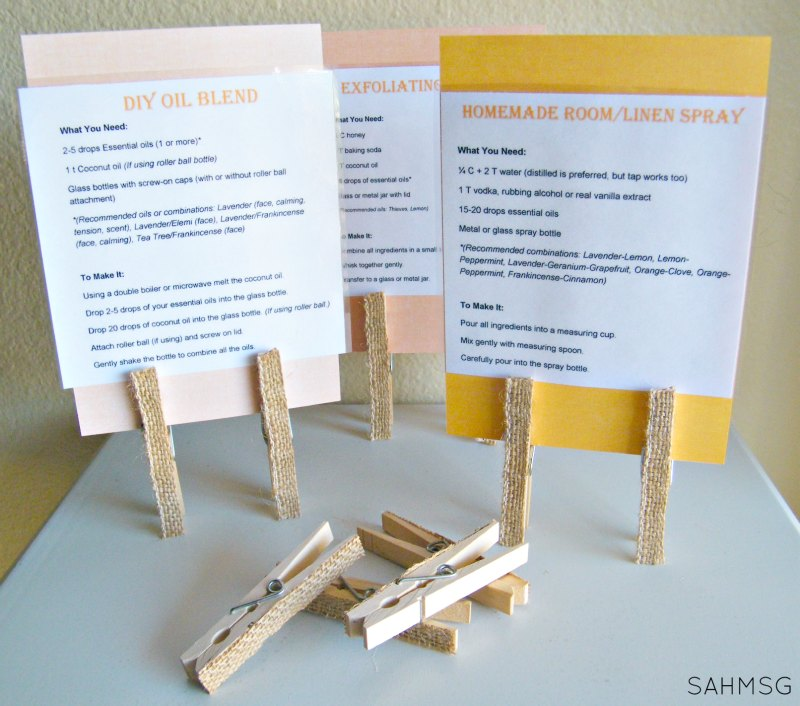 Essential oils make n take recipe card stands used at a holiday kickoff make n take playdate.