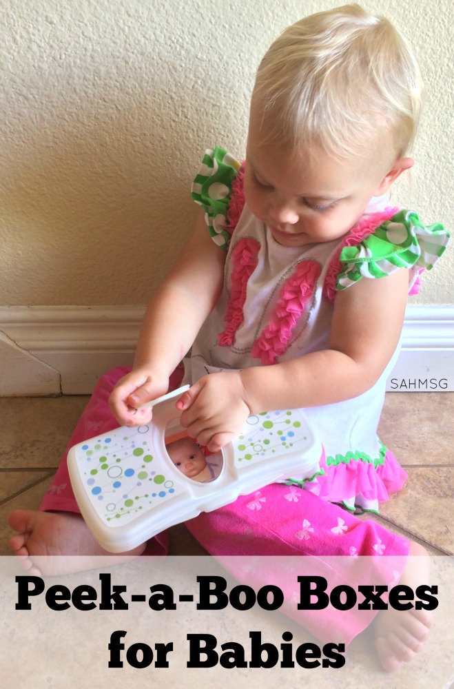 Simple DIY toy for infants-Peek-a-Boo boxes made from a wipes container or cardboard box teaches fine motor and object permanence skills to infants from 4 months and up.