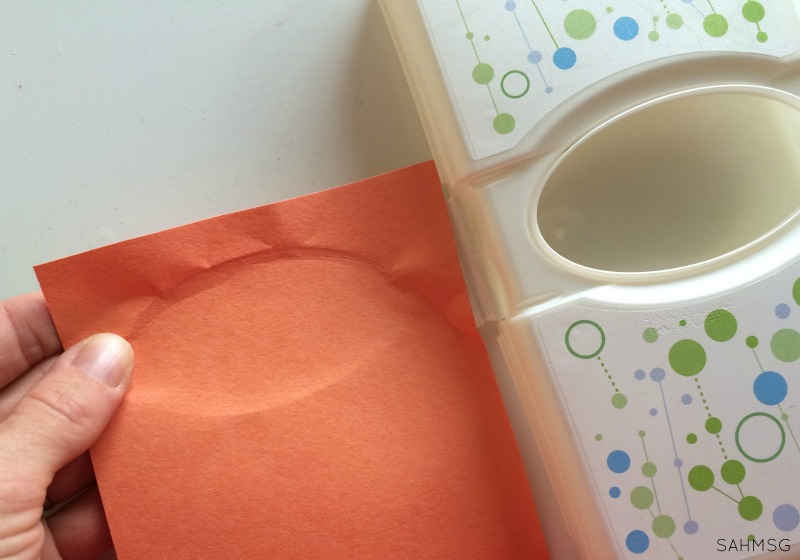 Peek-a-boo box for infants using a travel wipes container. Teaches name, and object permanence.