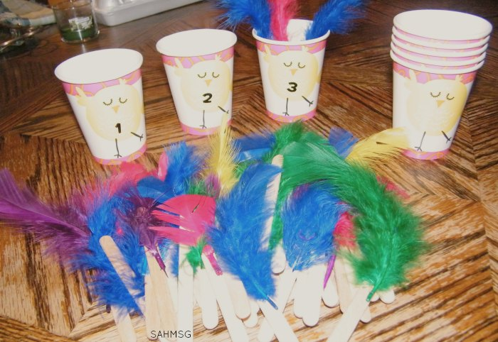Chick feather counting cups-preschool counting activity with an Easter and Spring theme all made with supplies from the dollar aisle.