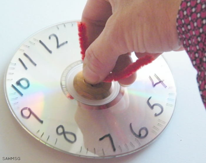 Common Core Math Games with hands-on math manipulative clock.