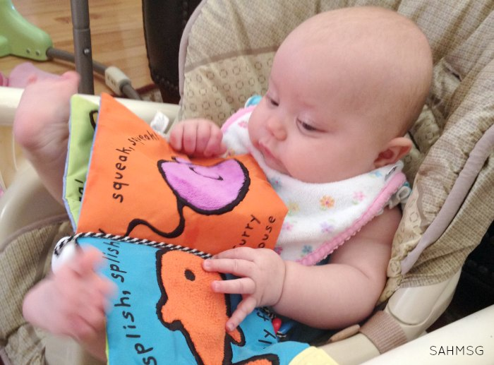 Reading books to your baby is a tip for moms to try when soothing a crying baby. 14 more tips to try in this list from a mom of 4. #Sponsored by @Gerber.