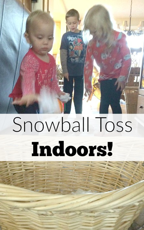 Too cold to play in the snow outside or don't have any snow where you live? Bring the snowball toss indoors for some gross motor fun for babies, toddlers, preschoolers and school age kids. This is so easy to set up with only two supplies. Great for indoor winter fun!
