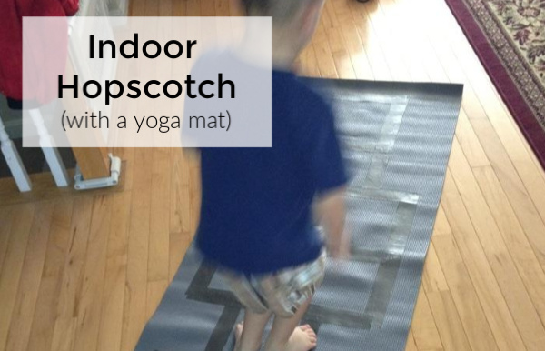 Indoor hopscotch made with a yoga mat is a great way to keep kids active - safely - indoors when the weather is cold or rainy outdoors. Perfect indoor activity for kids.