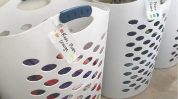 Laundry tips to save time: labeled hampers so kids can sort their own laundry.